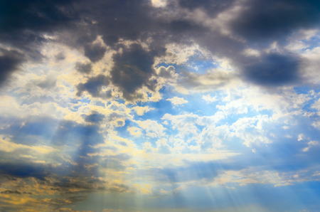 Blu sky with clouds and sun rays Stock Photo