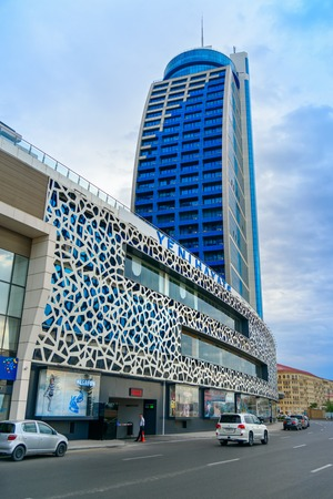 Baku, Azerbaijan - September 12, 2016: Building of multifunctional complex Azur. Former name New Life City, Yeni Hayat. It consisting of business center, residences and shopping and entertainment center Stok Fotoğraf - 73664066