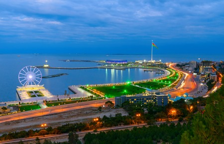 Baku, Azerbaijan - September 11, 2016: Night view of the city, Ferris wheel and National Flag Square. Baku is the largest city on the Caspian Sea and of the Caucasus region