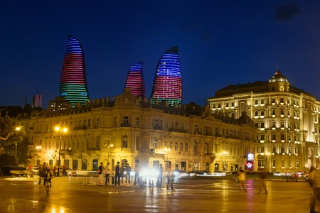 Baku, Azerbaijan - September 10, 2016: Night view of city with Flame Towers from Seaside boulevard. Baku is the largest city on the Caspian Sea and of the Caucasus region