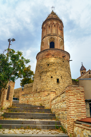 george: Bell tower of St. Georges Church in Sighnaghi city at Kakheti region. It is City of Love in Georgia, with many couples visiting it just to get married Stock Photo