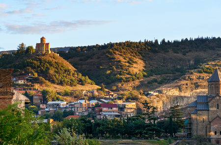 sinlight: View of Old city and Tabor Monastery on top of mountain at sunset. Tbilisi, Georgia