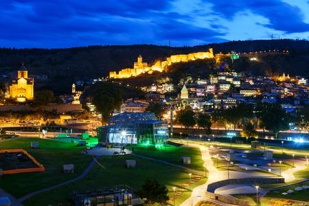 View of night city. Rike Park , Old city, Metekhi bridge and church and Narikala fortress at night. Tbilisi, Georgia Stock Photo