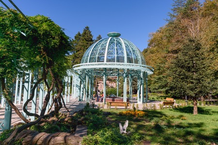Borjomi, Georgia - October 01, 2016: Blue pavilion with hot source in Mineral water park