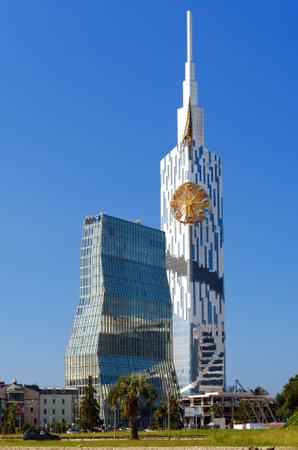 Batumi, Georgia - October 04, 2016: Modern skyscraper building with small ferris wheel and Radisson Blu Hotel