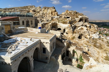 rock formation: View of cave houses in mountains at Urgup. Cappadocia. Nevsehir Province. Turkey