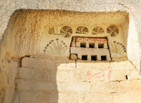 rock formation: Painting on window of Columned Church or White church in Rose valley. Nevsehir Province. Turkey