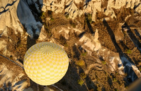 Top view of Hot air balloon flying over valley of Cappadocia in the morning. Nevsehir Province. Turkey.