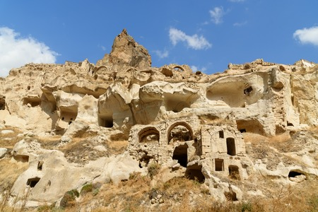 View of Ortahisar castle and cave houses in rock formation at Ortahisar. Cappadocia. Nevsehir Province. Turkey