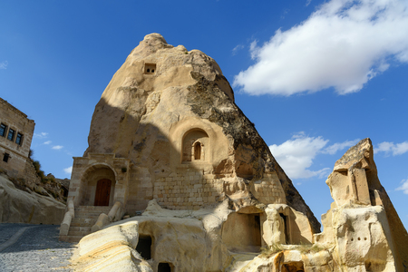 View of cave houses in mountains at Urgup. Cappadocia. Nevsehir Province. Turkey