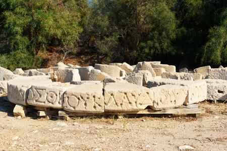 Stone with carved script near lighthouse in ancient Lycian city Patara. Antalya Province. Turkey Stock Photo