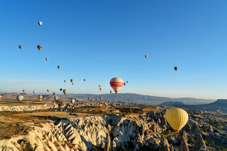Goreme, Turkey - October 16, 2016: Hot air balloons flying over valley of Cappadocia in the morning. Nevsehir Province. Turkey.
