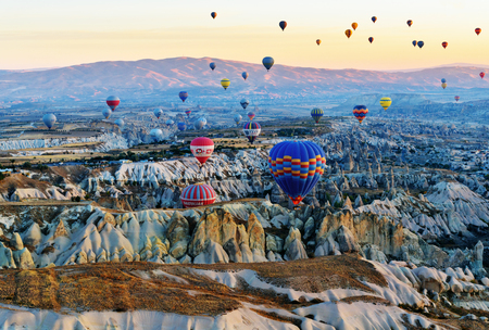 Goreme, Turkey - October 16, 2016: Hot air balloons flying over valley of Cappadocia at sunrise. Nevsehir Province. Turkey. Top view from other balloon