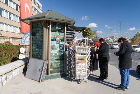 Istanbul, Turkey - November 02, 2016: Newspaper kiosk on the street. People buy newspapers.