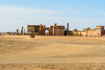 Merzouga, Morocco - Jan 6, 2017: View on Hotel Ksar Bicha near Erg Chebbi Sand dunes in Sahara Desert