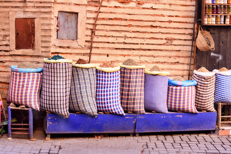 Big bags with herbs and spices in market at medina. Marrakesh. Morocco Stock Photo