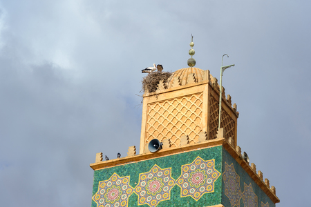 Nest of storks on minaret at Sidi El Ghamli Mosque in Settat city. Morocco