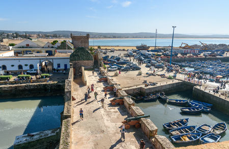 Essaouira, Morocco - December 31, 2016: View of Old Fortress Sqala du Port and port whith blue fishing boats Editorial