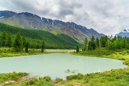Small lake in Aktru valley and view on North-Chuiskiy Range. Altai Republic, Siberia. Russia