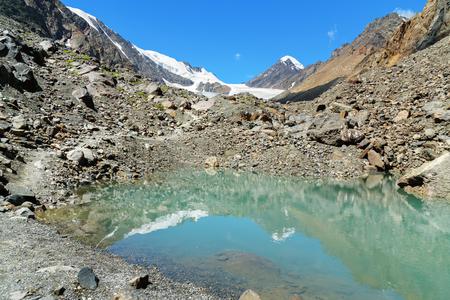 Small lake on mountain in Aktru valley. Altai Republic, Siberia. Russia