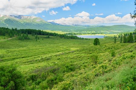 Ulagan lakes in valley on Ulagan plateau near Aygulaksky mountain range. Altai Republic, Siberia. Russia