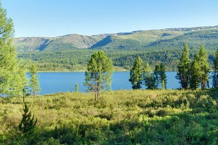 Taldukel lake in valley on Ulagan plateau near Aygulaksky mountain range. Altai Republic, Siberia. Russia