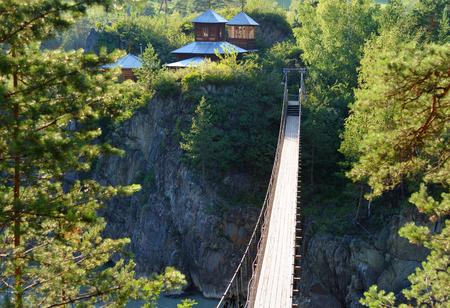 Suspension Bridge over Katun river to Island of Patmos. Chemal, Altai Republic, Russia