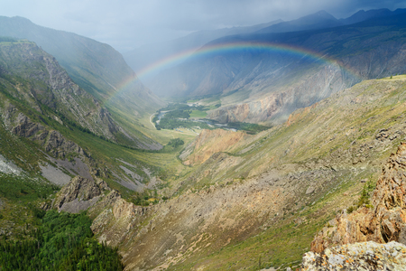 View on valley of Chulyshman river from pass Katu-Yaryk with rainbow. Altai Republic, Siberia. Russia