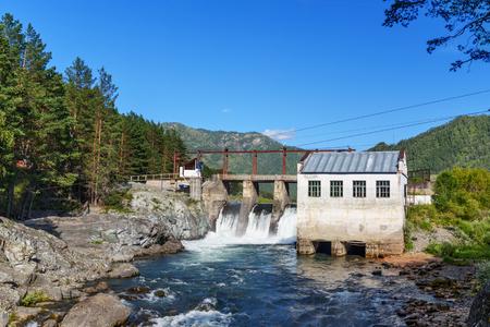 Old hydroelectric power station on the river Chemal. Chemal, Altai Republic, Russia Archivio Fotografico