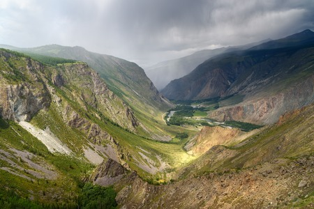 View on valley of Chulyshman river from pass Katu-Yaryk with rain. Altai Republic, Siberia. Russia