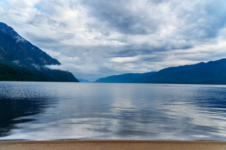 Teletskoye Lake in the morning in cloudy. View from southern shore. Altai Republic, Siberia. Russia 스톡 콘텐츠