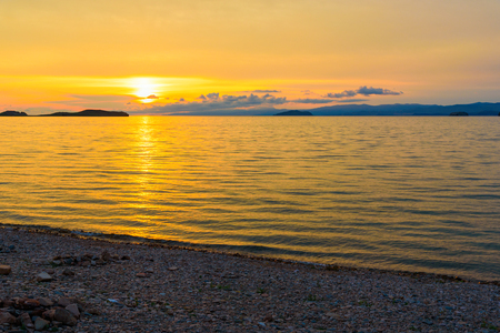 View of sunrise on Maloe More. Lake Baikal in the morning. Russia