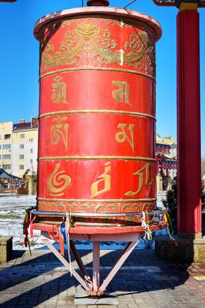 Prayer wheel inside the pagoda in Buddhist complex Golden Abode of Buddha Shakyamuni in spring. Elista. Kalmykia. Russia