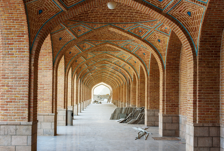 Arched corridor in courtyard of Blue Mosque. The mosque were constructed in 1465. Tabriz. East Azerbaijan province. Iran Stock Photo