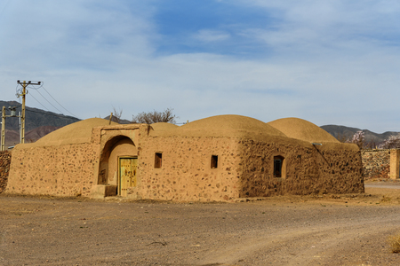 Old houses with dome roof. Traditional Iranian adobe village in Isfahan province. Iran