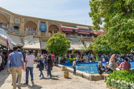 Shiraz, Iran - March 25, 2018: Terrace of Saraye Moshir Bazaar with fountain and small garden Editöryel