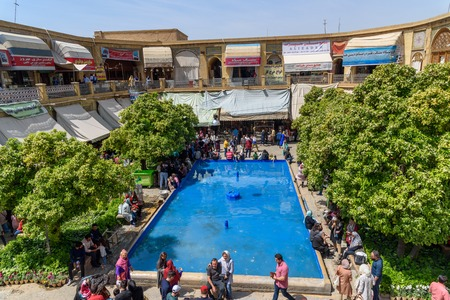 Shiraz, Iran - March 25, 2018: View of terrace of Saraye Moshir Bazaar with fountain and small garden Editöryel
