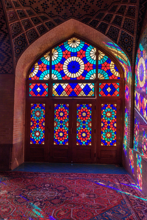 Stained glass window of Nasir Ol-Molk mosque, also famous as Pink Mosque in morning. Shiraz. Iran