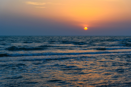 Sunset over the sea on wild beach of Persian gulf coast. Bushehr Province. Iran 版權商用圖片