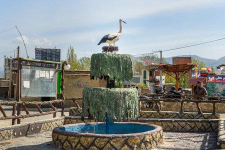 Marivan, Kurdistan, Iran - April 6, 2018: Statue Nest of storks in Darreh Tafi village near Zarivar lake, Darreh Tafi village, 15kms west of Marivan, is home to large number of white storks in spring