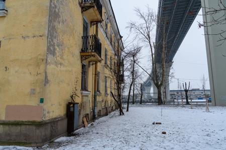 Western High-Speed Diameter over the houses on Kanonersky Island in winter in Saint Petersburg. Russia,