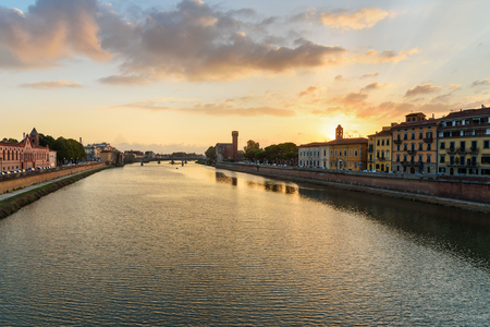 View on embankment of Arno river at sunset in Pisa, Italy 免版税图像