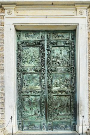 Bronze door of Pisa Cathedral in Pisa. Italy