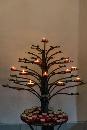 Candles burning in Church of Santa Maria assunta in Monteriggioni. Tuscany. Italy Stock Photo