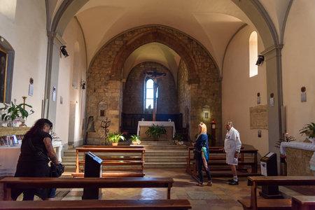 Monteriggioni, Italy - September 26, 2018: Interior of Church of Santa Maria assunta in Monteriggioni. Tuscany