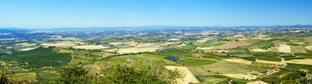 Panorama Beautiful view of vineyard and green field. Montalcino countryside, Tuscany, Italy