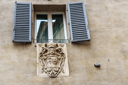 Coat of arms of noble families in wall in old city of Siena. Italy