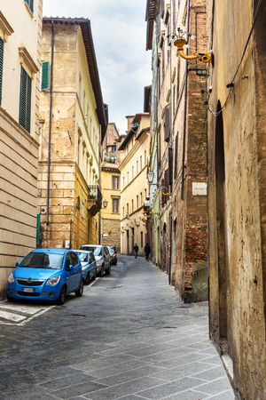 Siena, Italy - October 02, 2018: Medieval narrow street Casato di Sotto in old city Siena