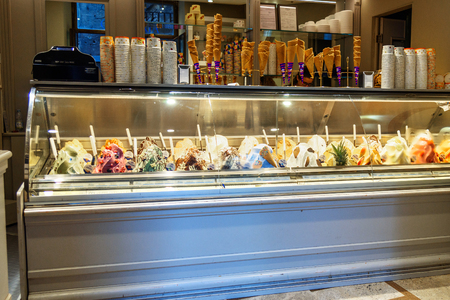 Siena, Italy - October 02, 2018: Italian ice-cream shop. Counter with different varieties of ice cream