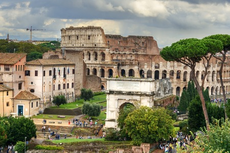 View of Colosseum and Ruins of Roman Forum. Arch of Titus and others in Rome. Italy